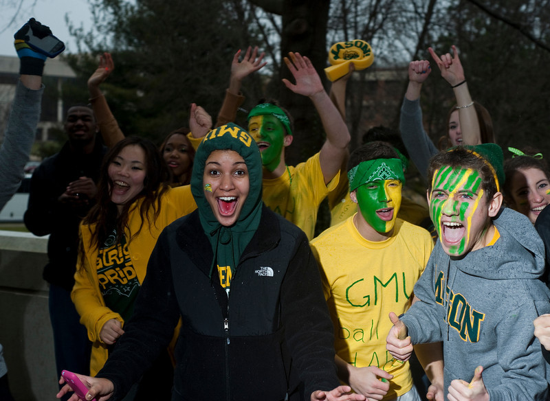 Students wait outside the Patriot Center for the Mason Homecoming 2012 basketball game at Fairfax Campus. Photo by Alexis Glenn/Creative Services/George Mason University