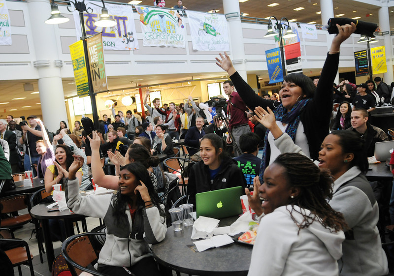 Students cheering at the Homecoming pep rally in the Johnson Center. Photo by Evan Cantwell/Creative Services