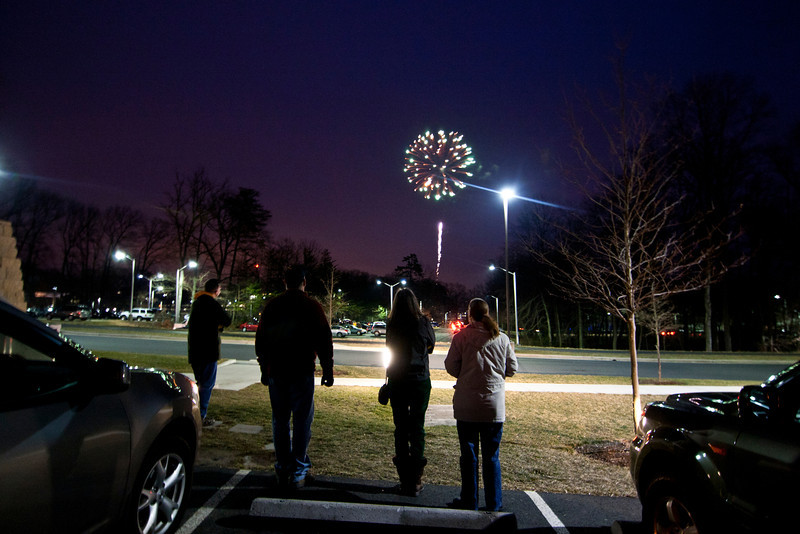 Alumni watch fireworks after the basketball game during Homecoming. Photo by Craig Bisacre/Creative Services/George Mason University