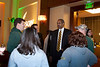 Men's Basketball head coach, Paul Hewitt, talks with alumni during the Homecoming alumni after party . Photo by Craig Bisacre/Creative Services/George Mason University