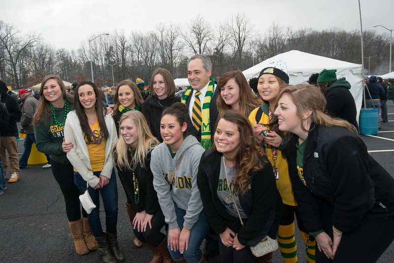 President Cabrera poses with students at the Homecoming 2013 block party. Photo by Evan Cantwell/Creative Services/George Mason University