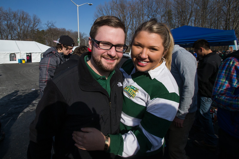 Students and alumni celebrate homecoming by tailgating outside in front of the Patriot Center before the Men's Basketball game against Richmond. Photo by Craig Bisacre/Creative Services/George Mason University