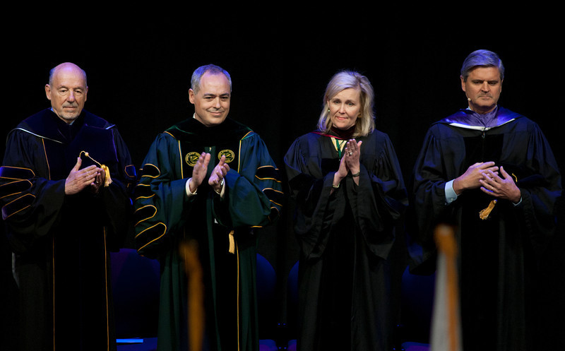 (L to R) Board of Visitors Rector C. Daniel Clemente, President Ángel Cabrera, Virginia Secretary of Education Laura Fornash, and Chair and CEO of Revolution Steve Case attend the Installation Ceremony of the Inauguration of Ángel Cabrera at the Patriot Center. Photo by Craig Bisacre/Creative Services/George Mason University