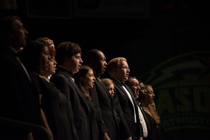 "School of Music choral students sing ""Patriot Pride"" (alma mater) during the Installation Ceremony of the Inauguration of Ángel Cabrera at the Patriot Center. . Photo by Evan Cantwell/Creative Services/George Mason University"