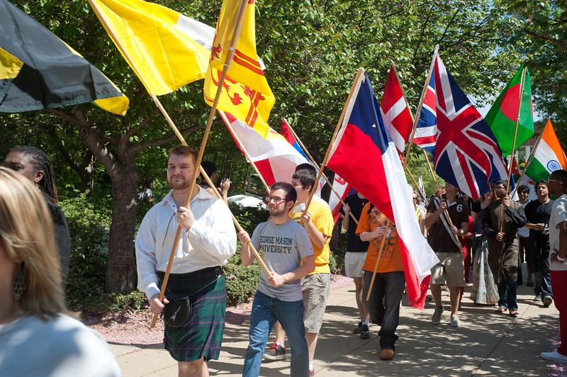 Students carry flags at the International Week Opening Ceremony Parade on Fairfax Campus. Photo by Alexis Glenn/Creative Services/George Mason University