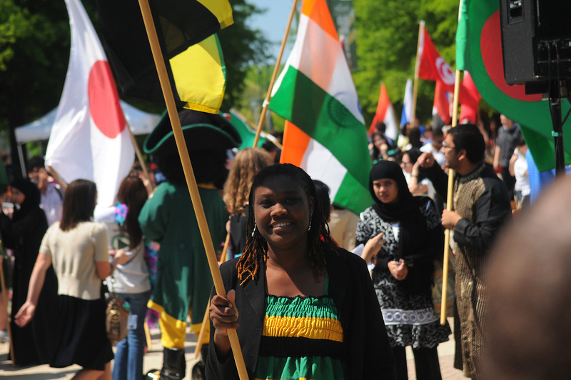 Mason students from around the globe carry flags in the International Week flag parade. Photo by Evan Cantwell/Creative Services/George Mason University
