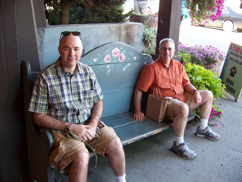 Pat and Dave take a breather on a bench on Front Street.<br /> [Leavenworth, WA]