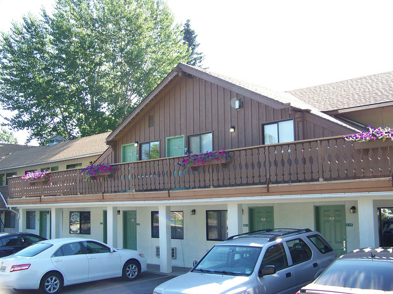 "Our room was on the upper floor in the pointy-roofed ""chalet"" section seen here (ours was the green door on the right).  I didn't take any interior shots, but it was an awesome three-bedroom suite.  We each had our own TV in the bedrooms, and there was a fourth one in the living room, mounted above a gas fireplace.  There was no kitchen, but it did have a small refrigerator/freezer and a microwave.  The hotel had a nice breakfast buffet in the morning, including hot food (eggs, sausage, waffles).  We only paid about $180 for the room, which was a real bargain considering we split the cost three ways.<br /> [Leavenworth, WA - Fair Bridge Inn & Suites]"