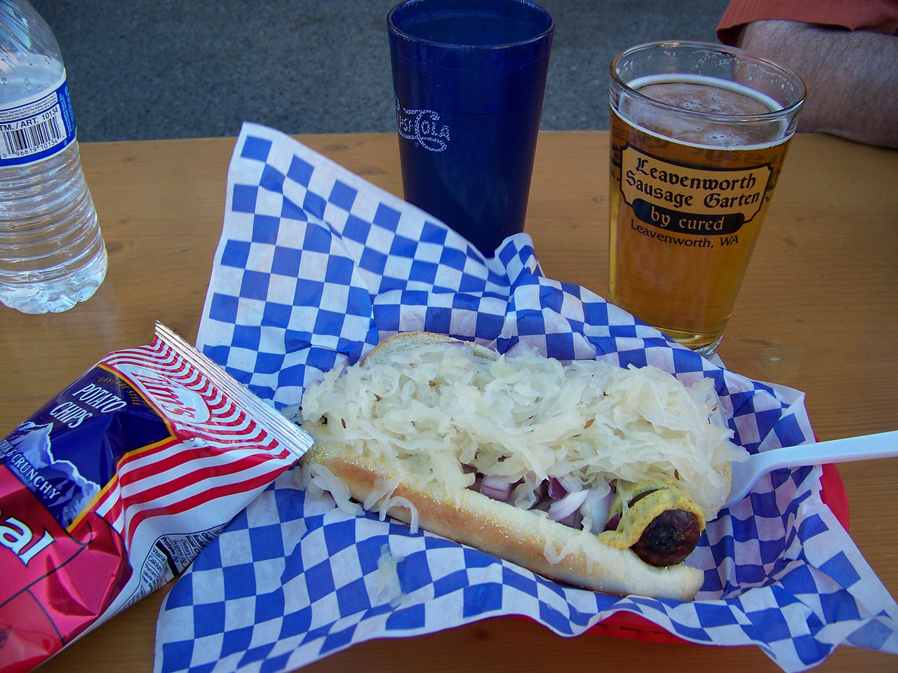 I can't remember now which sausage I chose at the Sausage Garten (kielbasa?), but it was very good!  They had a topping bar where I added my own spicy mustard, onions, and hot sauerkraut.<br /> [Leavenworth, WA]