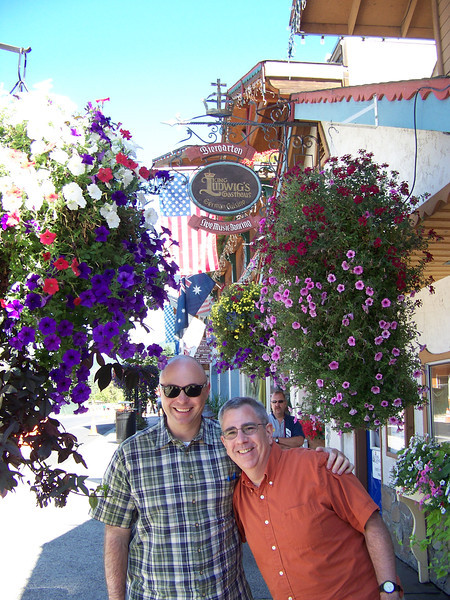 Pat and Dave with some of the beautiful flowers along Front Street.  We were all amazed at the quantity and size of the hanging baskets we saw here!<br /> [Leavenworth, WA]