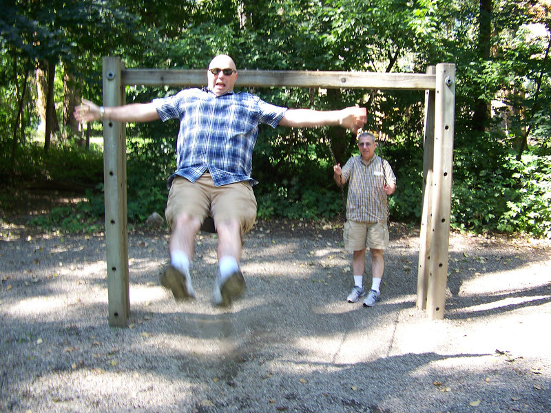 Wheeeee!!!!!  Pat goes airborne on the swing in Waterfront Park as Dave looks on.<br /> [Leavenworth, WA]