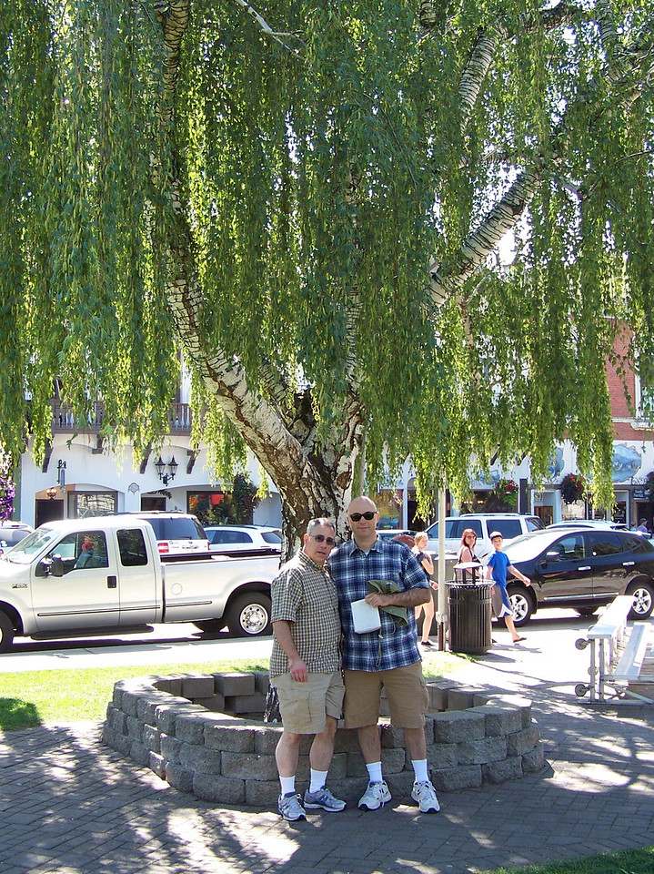 Dave and Pat under a weeping willow in the little park next to Front Street.<br /> [Leavenworth, WA]
