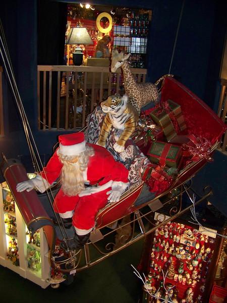 Santa Claus and his sleigh flew (okay, <b><i>hung</b></i>) in the atrium inside the Kris Kringl Christmas shop. [Leavenworth, WA]