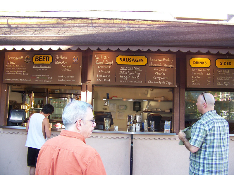"Dave and Pat ponder the menu at the Leavenworth Sausage Garten, where we had dinner.  The sausage served here comes from a nearby shop called <b><a target=""_new"" href=""http://www.curedbyvisconti.com/"">Cured</a></b> where you can buy all manner of cured meats to take home. [Leavenworth, WA]"