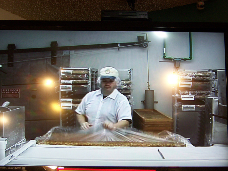 In the gift shop, they played a short video showing the production area for those who didn't have time for the tour.  Dave recognized his nephew Mike in the video (seen here).  The video is getting a little old--Mike hasn't worked here in about a decade!<br /> [Cashmere, WA - Aplets & Cotlets factory tour]