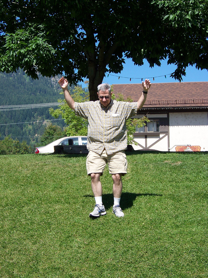 I dared Dave to roll down this grassy slope in the little park, but he only ran down it.  :-)<br /> [Leavenworth, WA]