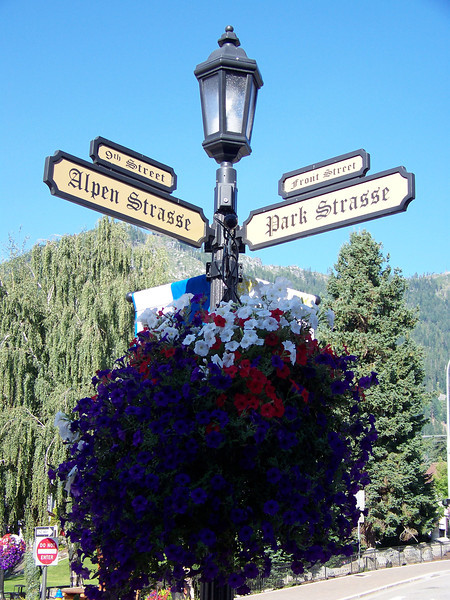 In the city's core, each street also has a German name.  You can see on this sign that Front Street is also called Park Strasse.<br /> [Leavenworth, WA]