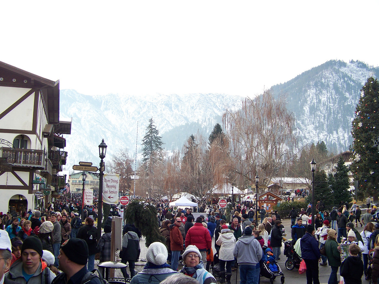 """Despite the lack of snow, tons of people still came here for the shopping, dining, and the Christmas Lighting Ceremony that they do every weekend during December.  This is looking toward Front Street Park, which will be the focus of the festivities after dark. [Leavenworth, WA - December 2013 - <b><a target=""""_new"""" href=""""http://youtu.be/NqCqDCOY_tc"""">Watch my video here</a></b>]"""