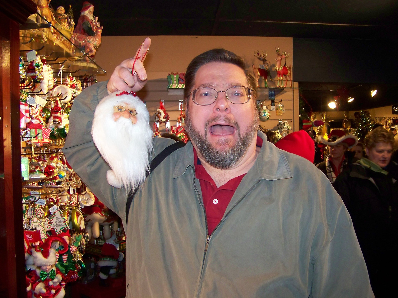 """Jon is horrified to discover the severed and shrunken head of Santa!!!  (Or maybe that's just a disturbingly large ornament at the Kris Kringl Christmas shop.) [Leavenworth, WA - December 2013 - <b><a target=""""_new"""" href=""""http://youtu.be/NqCqDCOY_tc"""">Watch my video here</a></b>]"""