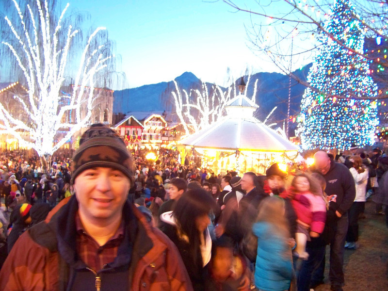 """While Dave went to church, Pat and I watched the Christmas Lighting Ceremony at dusk.  This shot was taken right after the short ceremony ended--what a crowd!! [Leavenworth, WA - December 2013 - <b><a target=""""_new"""" href=""""http://youtu.be/NqCqDCOY_tc"""">Watch my video here</a></b>]"""