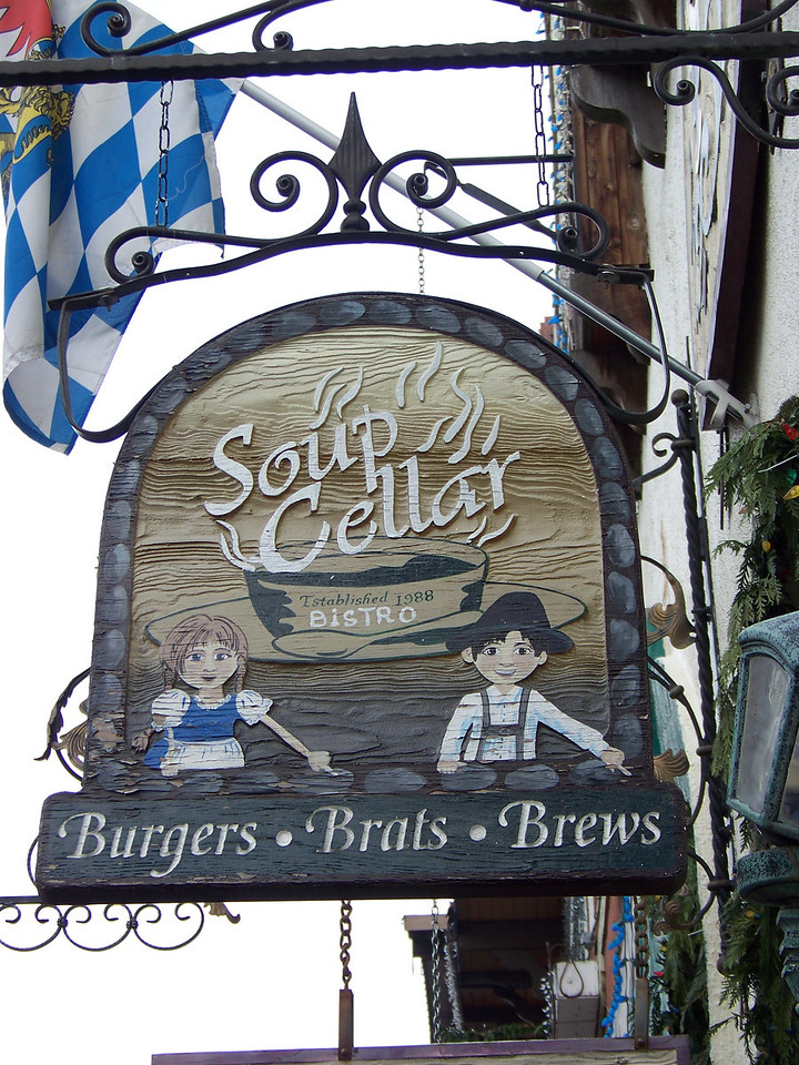 """We arrived in time for lunch, so we went to the Soup Cellar.  The kids on the sign are pointing the way to the restaurant. [Leavenworth, WA - December 2013 - <b><a target=""""_new"""" href=""""http://youtu.be/NqCqDCOY_tc"""">Watch my video here</a></b>]"""