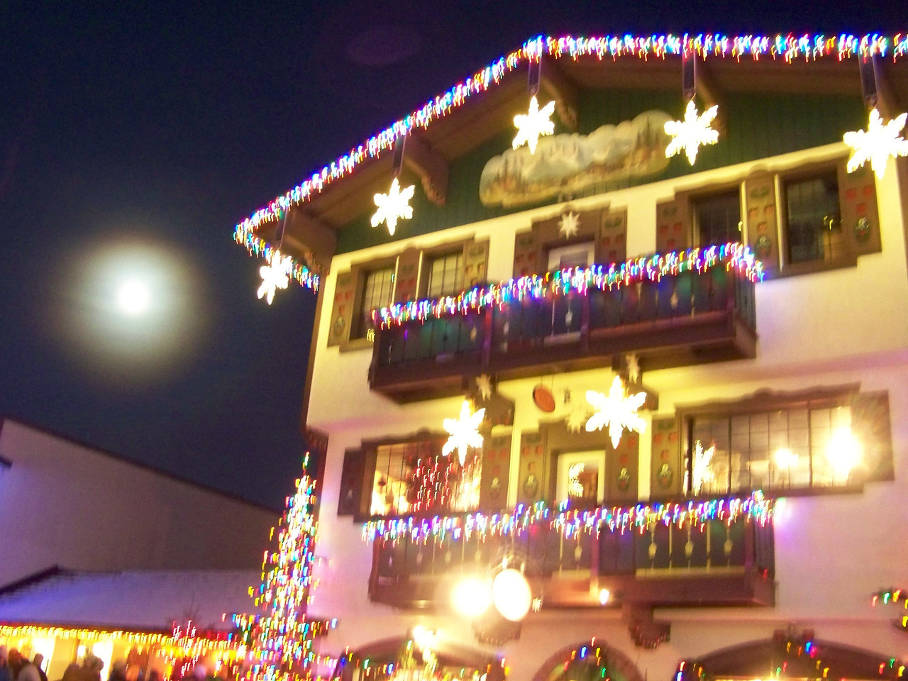 """The moon was nearly full, and complemented the Christmas lights nicely.  The cloudless sky meant that the temperature really plunged after dark.  I never did see an exact temperature, but it must've been in the 20s, at least. [Leavenworth, WA - December 2013 - <b><a target=""""_new"""" href=""""http://youtu.be/NqCqDCOY_tc"""">Watch my video here</a></b>]"""