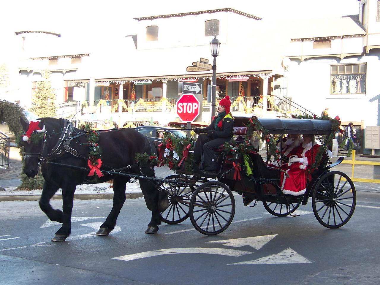 """A horse-drawn carriage full of VIPs arrived to get the party started.  After this, you could wait in line for a free carriage ride, too (although we didn't). [Leavenworth, WA - December 2013 - <b><a target=""""_new"""" href=""""http://youtu.be/NqCqDCOY_tc"""">Watch my video here</a></b>]"""