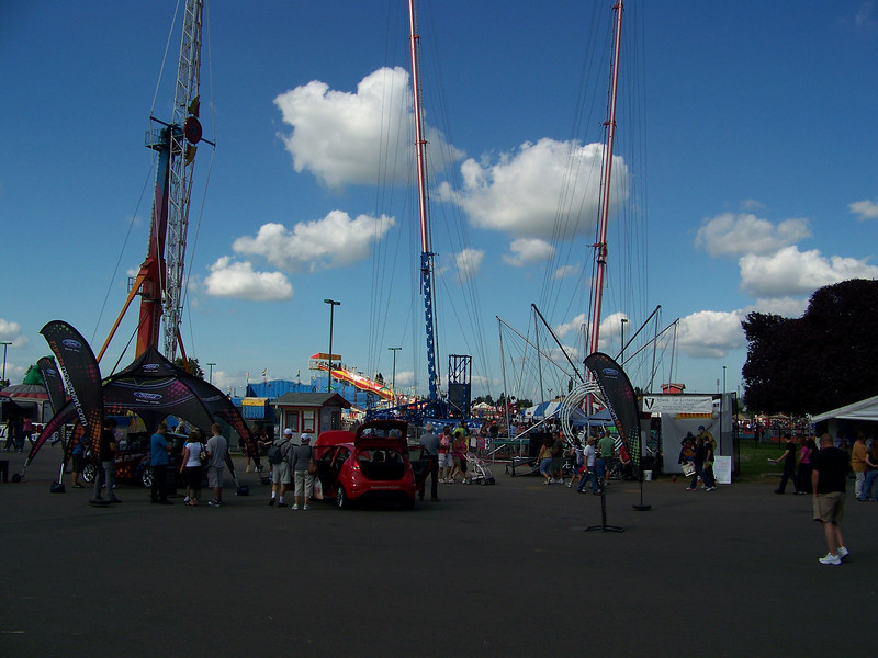 The towers on the right and center were for the bungy slingshot ride.<br /> [Puyallup, WA Fair 2009]