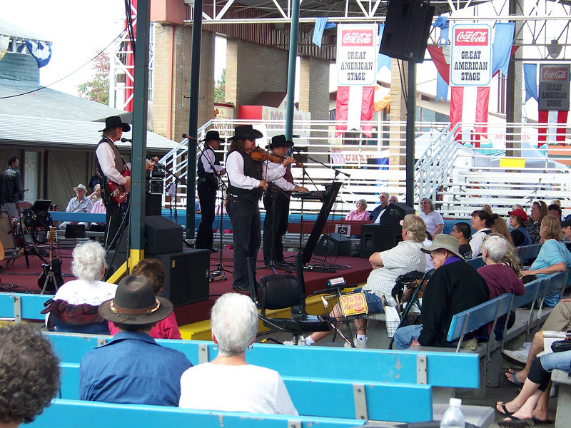 """The Coca-Cola Great American Stage featured free music from a variety of acts throughout the day.  When we stopped by, the country band """"The Doo-Wah Riders"""" were performing.<br /> [Puyallup, WA Fair 2009]"""