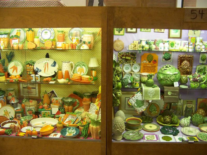 Carrot-ware to the left, and artichoke-ware to the right in the display cases inside Hobby Hall.<br /> [Puyallup, WA Fair 2009]