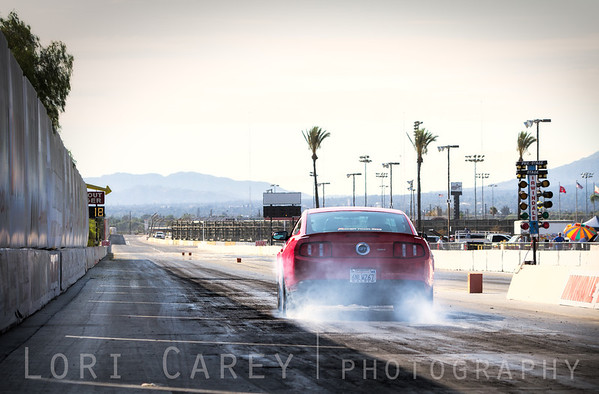 Photographer John McCabe smokes the tires on the Irwindale Dragstrip at the press launch of Cie Studios' Racing Rivals game for iOS. 29 August 2013