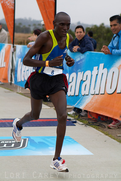 Weldon Kirui sprints toward the finish line for a fourth place win in the San Diego Rock and Roll Marathon on June 3, 2012.