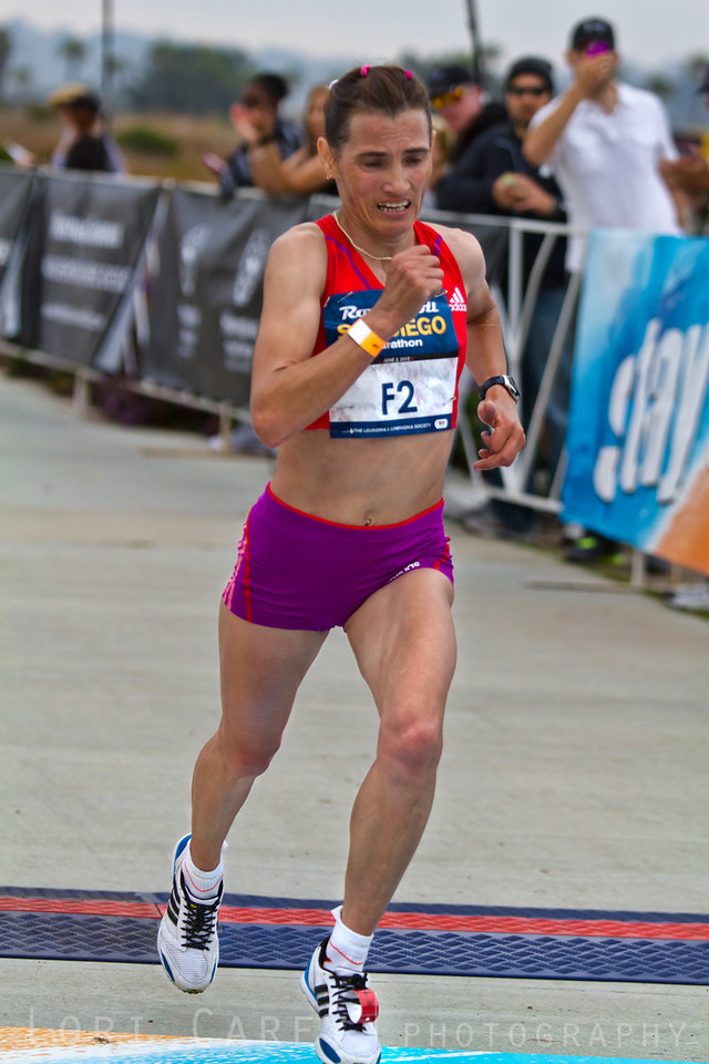Russian Alevtina Ivanova comes down the home stretch to be the first woman to cross the finish line in the Rock and Roll San Diego marathon on June 3, 2012