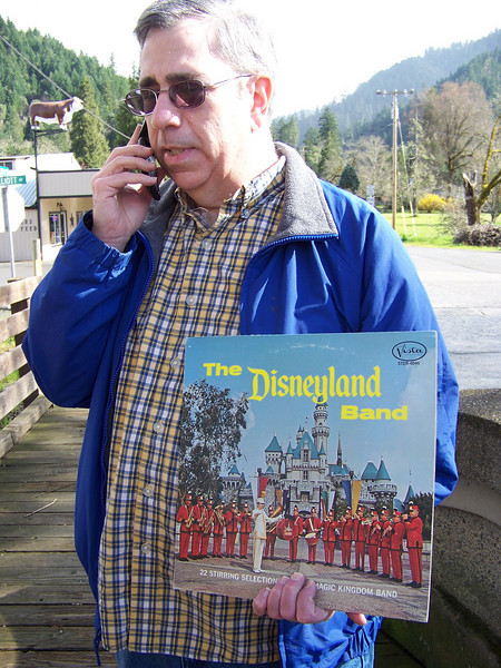 Dave bought a Disneyland Band LP at the antique store!  I made him display it while he was on the phone with his dad.<br /> [Canyonville, OR]