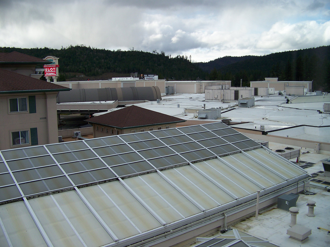 Our hotel room also looked across the roof of the casino, which shows how large the entire complex is.  Directly in front, the sloped part of the roof is over the hotel's swimming pool.<br /> [Seven Feathers Resort in Canyonville, OR]