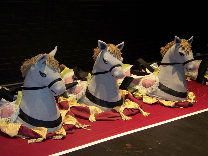 Toy horse costumes lined up backstage.  Some of the kids in the show wore these suspended from their shoulders, so it would look like they were galloping on a horse across the stage.<br /> [Backstage at Pacific Northwest Ballet's Nutcracker - 2013]