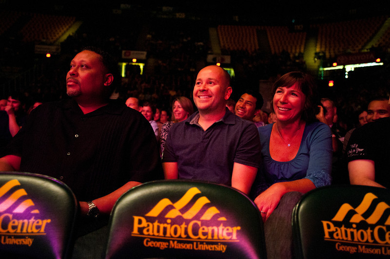 Attendees laugh as comedian Keith Robinson performs before comedian Wanda Sykes at the Patriot Center, Fairfax Campus - 111015506
