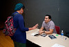 "Novelist and Short Story Writer Manuel Muñoz speaks with a student as he signs a copy of his Hitchcock-inspired debut novel, ""What You See in the Dark"" at Dewberry Hall in the Johnson Center, Fairfax Campus during the 2011 Fall for the Book festival. Photo by Alexis Glenn"