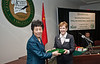 111024512 - Madame Yan Junqi, Vice Chair of China's People's Association of Peace and Disarmament, accepts a gift from Mason Vice President and CIO, Information Technology Unit Joy Hughes at the Forum on Global Education as part of the Educating Global Citizens: The US, China, and the World program