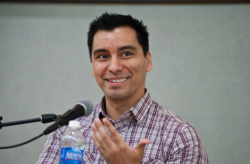 """Novelist and Short Story Writer Manuel Muñoz reads from and discusses his Hitchcock-inspired debut novel, """"What You See in the Dark"""" at Dewberry Hall in the Johnson Center, Fairfax Campus during the 2011 Fall for the Book festival. Photo by Alexis Glenn"""