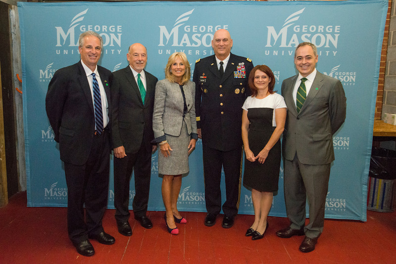 (L to R) CEHD Dean Mark Ginsberg, Dan Clemente, Dr. Jill Biden, Army Chief of Staff General Raymond Odierno, (unidentified), and President Ángel Cabrera pose for a photo at an event hosted by the American Association of Colleges for Teacher Education (AACTE) and the Military Child Education Coalition (MCEC). Photo by Alexis Glenn/Creative Services/George Mason University