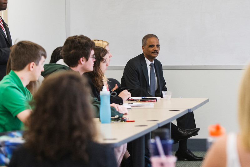 U.S. Attorney General Eric Holder listens to Laurie Robinson during her class in University Hall. Photo by Craig Bisacre/Creative Services/George Mason University