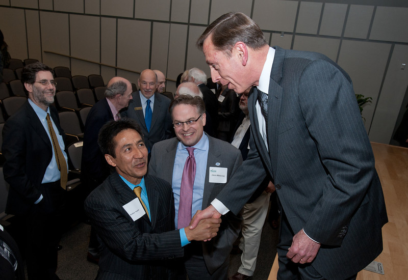 Director of the Central Intelligence Agency General David H. Petraeus shakes hands with Arlington County Board Member Walter Tejada at the dedication of Founders Hall on the Arlington Campus of George Mason University in Arlington, Virginia on March 8, 2012. Photo by Alexis Glenn/Creative Services/George Mason University