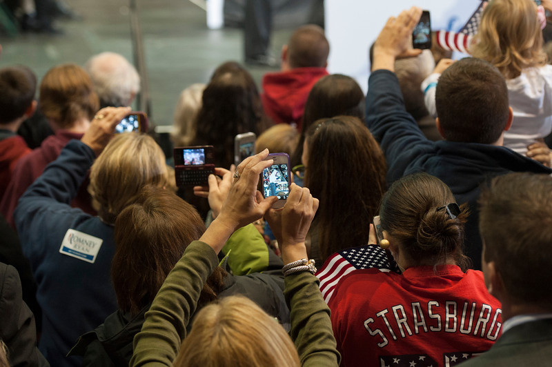 The crowd takes photos with their smartphones as Republican Presidential Candidate Mitt Romney speaks at a campaign rally at the Patriot Center at Fairfax campus. Photo by Alexis Glenn/Creative Services/George Mason University