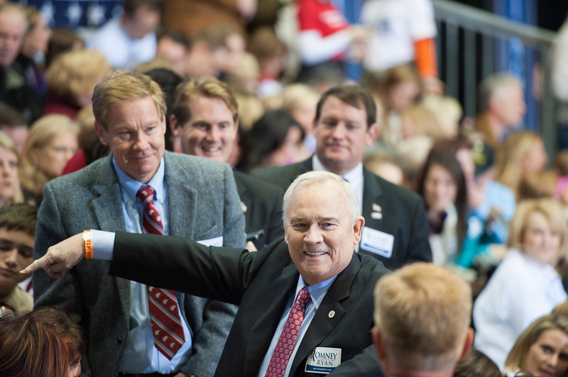 Robert Pence, member of the Board Visitors, and former Congressman Tom Davis attend a campaign rally for Republican Presidential Candidate Mitt Romney at the Patriot Center at Fairfax campus. Photo by Alexis Glenn/Creative Services/George Mason University