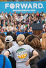 A student wearing a Mason Votes shirt waits to see U.S. President Barack Obama speak at a campaign rally at Fairfax campus. Photo by Alexis Glenn/Creative Services/George Mason University