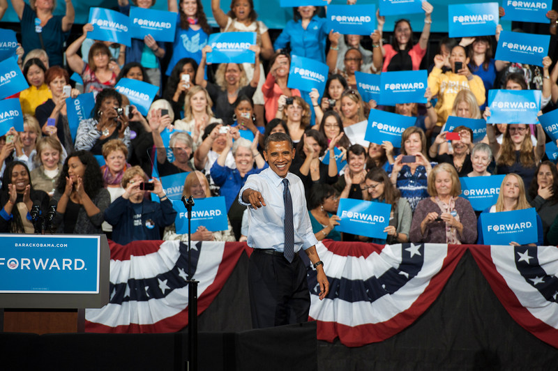 U.S. President Barack Obama greets the audience at a campaign rally at the Center for the Arts at Fairfax campus. Photo by Alexis Glenn/Creative Services/George Mason University