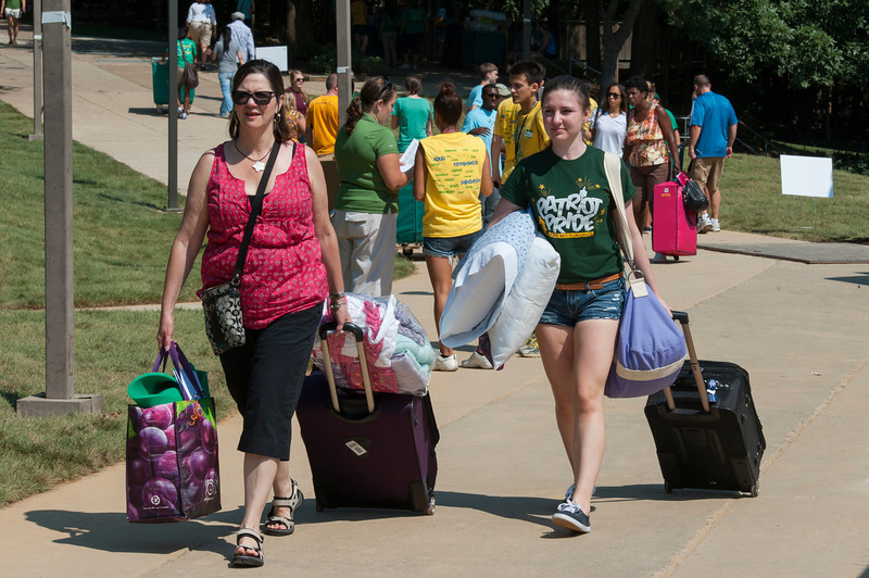 Freshman students and parents unload vehicles during Freshman move-in day in the Rappahannock neighborhood at Fairfax campus. Photo by Alexis Glenn/Creative Services/George Mason University