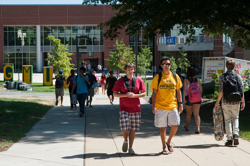 Students walk with each other between classes outside Skyline at Fairfax Campus. Photo by Alexis Glenn/Creative Services/George Mason University