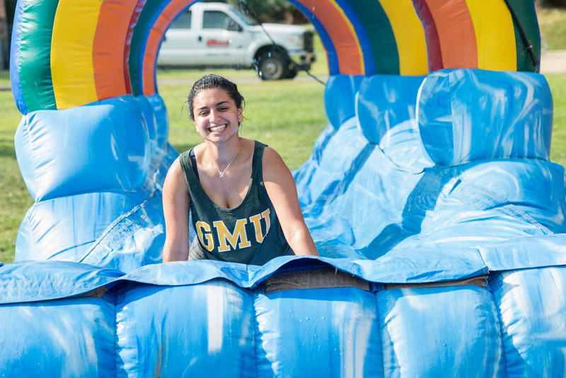 Students attend the neighborhood block parties in the ResidenceHalls.  Photo by Ron Aira/Creative Services/George Mason University